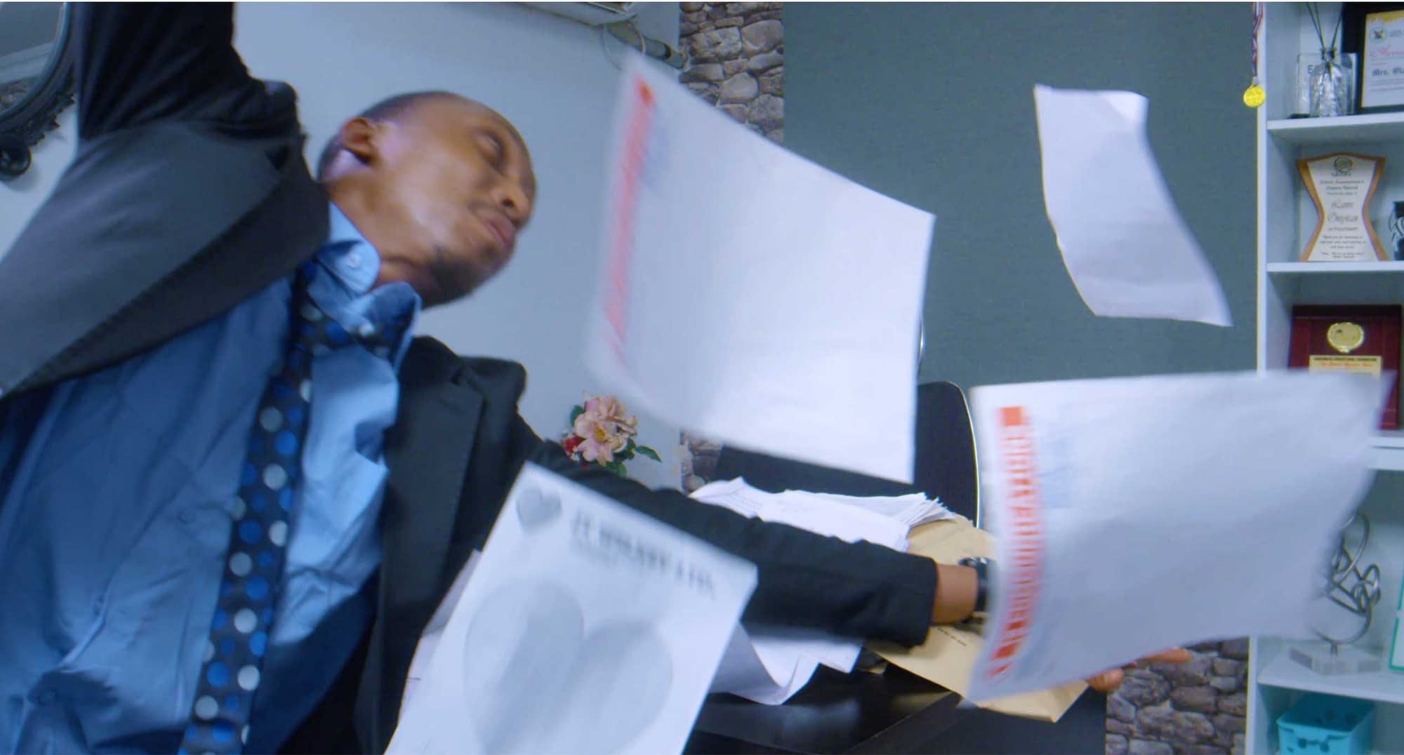 Frank Donga trying to catch flying paper