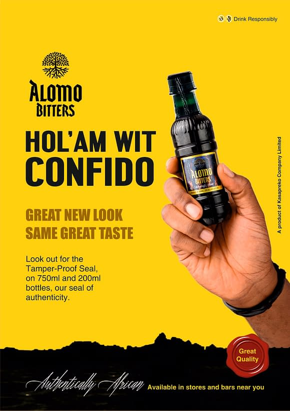 Hand holding Alomo Bitters drink